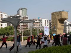 Rock Climbing Photo: Climber on portable wall, tai chi in fore. Kunming...