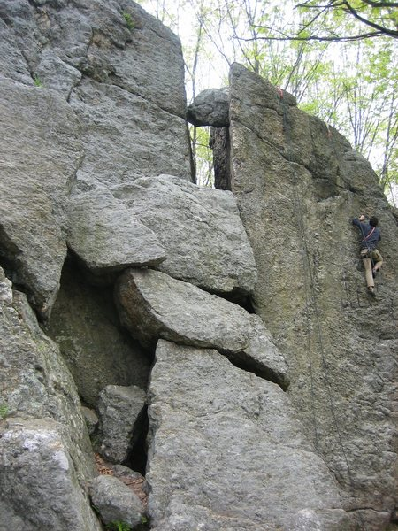 Acme climbs a crack on the left wall of the fissure.