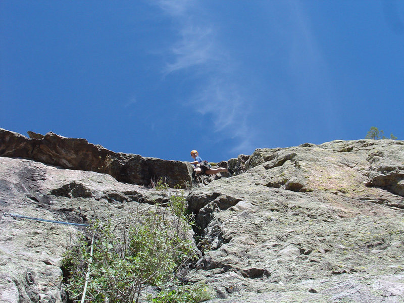 Amy leading in the gully on P2 of Juniper Direct with the Juniper Overhang roof visible to her left (Oct. 1, 2005).