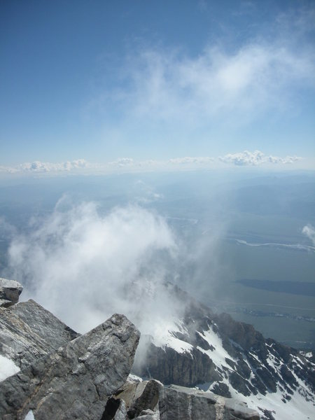 Up draft visible with the rising of the clouds; summit grand teton