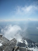 Rock Climbing Photo: Up draft visible with the rising of the clouds; su...
