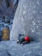 Rock Climbing Photo: Allen bearing down for more weather on the first p...