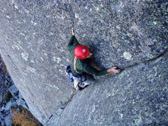 Rock Climbing Photo: Allen finds comfort from the storm as he nears the...