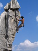 Rock Climbing Photo: Wang Zhiming high-bouldering the karst.