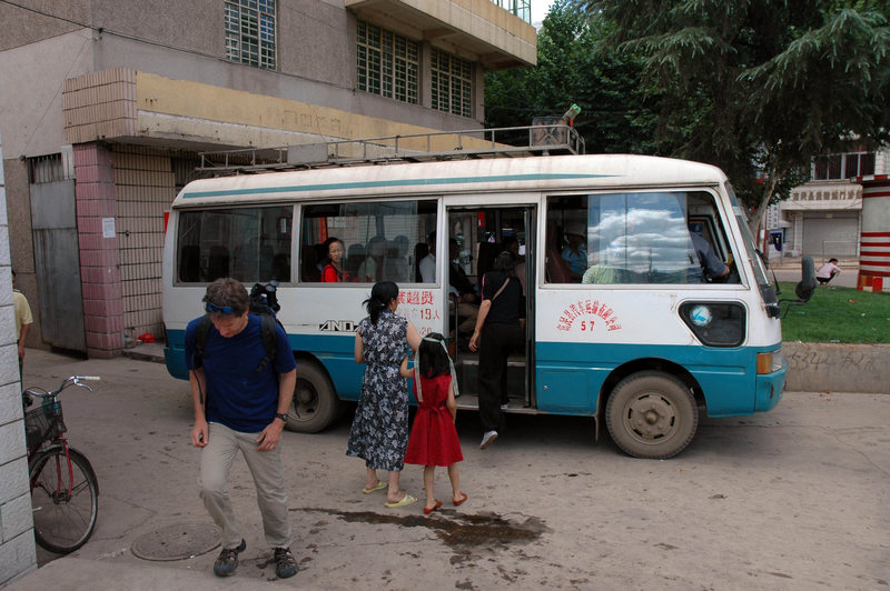 Disembarking from the Kunming bus in Fumin town, headed for the second leg of the trip via horse cart or motorcycle taxi.