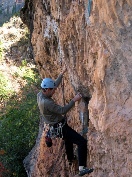This crag is out of the way and does not get climbed much. Be sure to bring old rope or webbing to replace the threads.