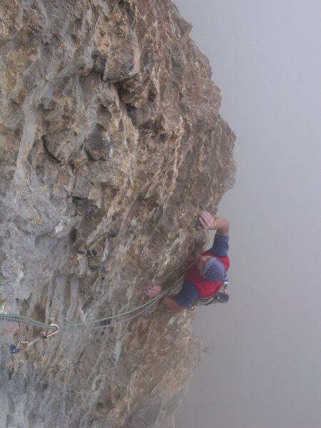 Pitch three - my man Bill Flaherty, having just pulled through the overhanging crux of the route.