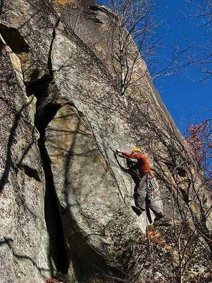 Jamie McNeill on FA of Eatin' Tripe and Lichen It.<br> Here, he is just returning to the left after bypassing the OW start via a good handcrack.<br> He will continue up the wide crack to the right of the overhang.