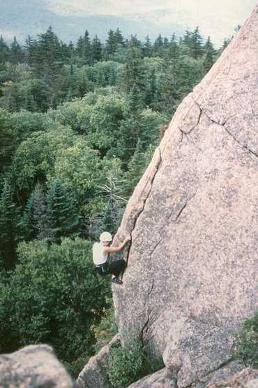 A climber works her way up the pillar after passing the crux starting move.