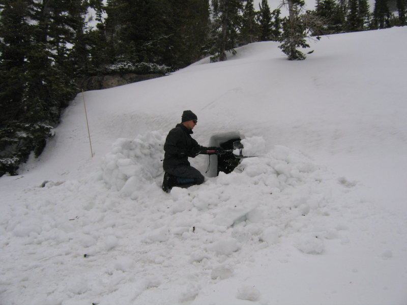 Nick busy on our snow cave.  This was a side project during bad weather.
