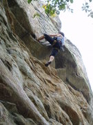Rock Climbing Photo: A heel hook makes the reach easier.