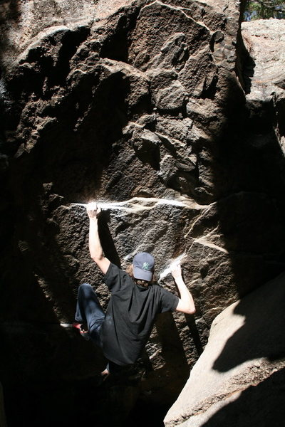 Moving through the crux on Cave Direct.