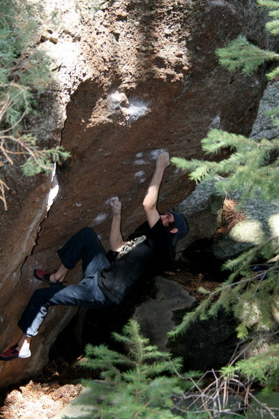 Moving through the crux on sharp pockets.
