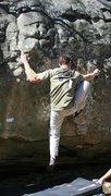 Rock Climbing Photo: Bradley K. pullin down on Getcha Some.