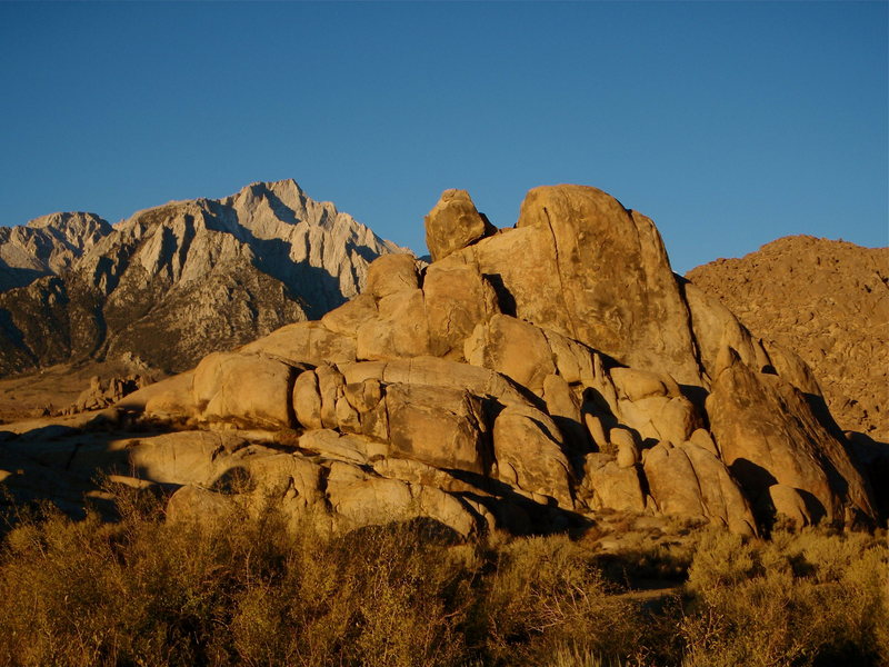 Lone Pine Peak from the Alabama Hills at sunrise. The  North Ridge is the prominent ridge leading directly off to the right from the summit and the Northeast Ridge is the closer of the two.