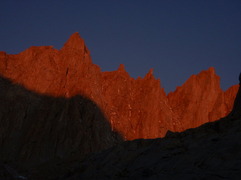 Morning alpenglow on Mount Muir, S'Brutal Tower and Aiguille Junior.