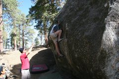 Rock Climbing Photo: Pulling up into the scoops on Problem C, V1
