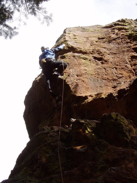 Clipping the last bolt after making the crux move.