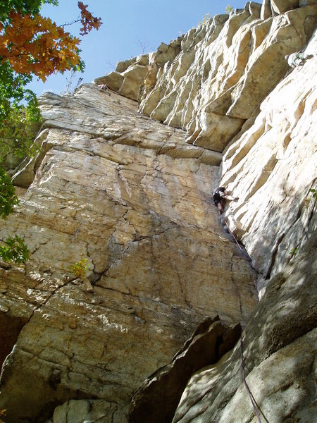 Gene Smith on P1 below the crux, and unknown climber finishing P2.