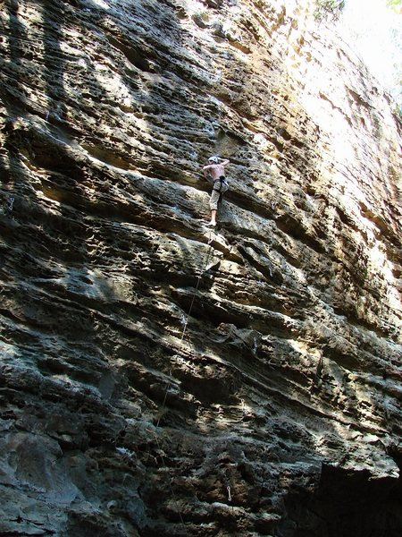 Bare Metal Teen on the 12 wall-- awesome route. The guidebook says it's one of the cruelest jokes at the Red to call this 12a... My bad kneebar rest before entering into the crux sequence and then trying not to pump out... Super fun route whatever difficulty you call it. October '08. Photo (all 3 of these) by Jay.