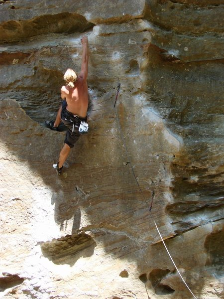 SteveZ working out the crux move on Ro just prior to sending.  October '08.