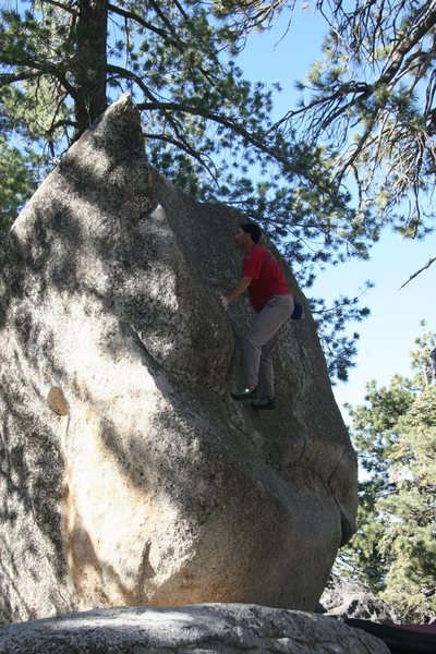Rock Climbing Photo: Moving passed the good hold up to the lip.