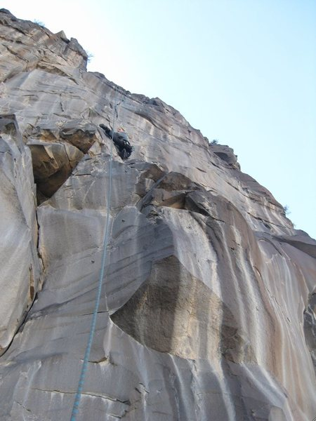 Kristin approaching the finger crack on the headwall; the best 5.11 trad-cragging pitch in the Southwest? It's gotta be one of them.