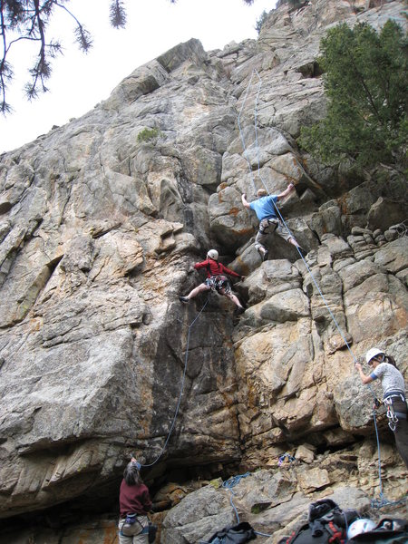 Bruno Hache starting up Is It Ready Yet...Moe (left), with another climber on Lazy Day (right).