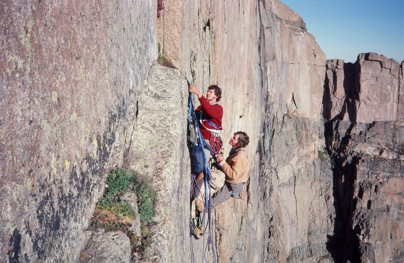 """Climbers at a hanging belay mid way up the """"Yellow Wall"""" on an early '80s direct aid ascent.<br> <br> Photo: Olaf Mitchell."""