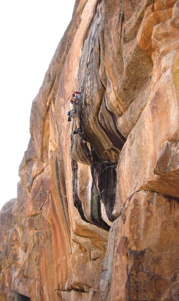 Dave Russell drilling on the first ascent.