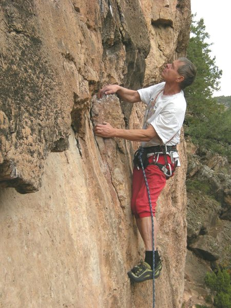Climbing legend Jim Erickson checks out his next set of moves.