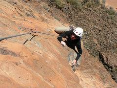 Rock Climbing Photo: Climbing on the arete through the crux of the thir...