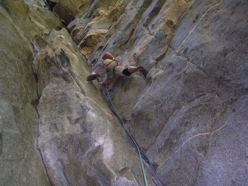 Starting the thin fingers and stemming crux on Gold Dust. Easy hike, nice belay zone, good pro, shady, and steep!