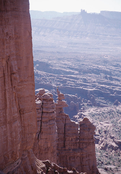 A climber on the corkscrew summit of Ancient Art as seen from Colorado Ridge on the Kingfisher.<br>