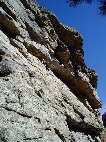 Rock Climbing Photo: Luke gaining the ledge below the crux.