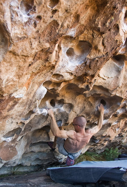 Dave on the easy V0 section, a decent rest can be obtained in the left hand hueco.<br> <br> Photo by Frank