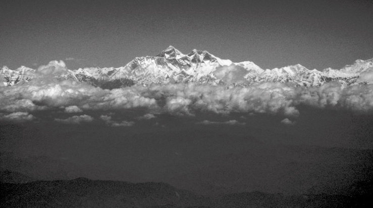 Plane ride from Bangkok to Kathmandu.  Definitely sit on the right side if you can.  Everest and Nuptse-Lhotse wall.