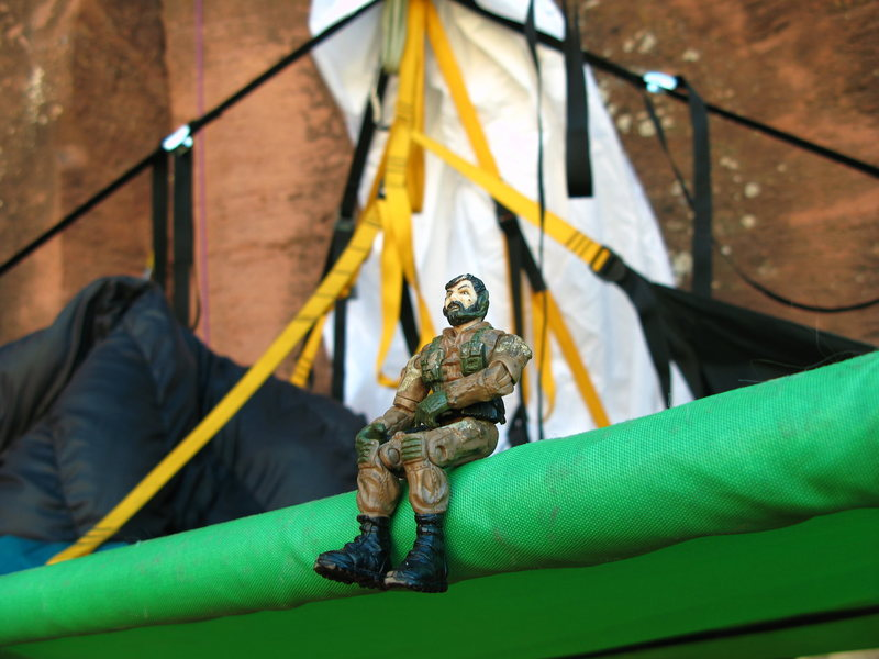 Rock Climbing Photo: A hard body, stern visage, and commando style are ...