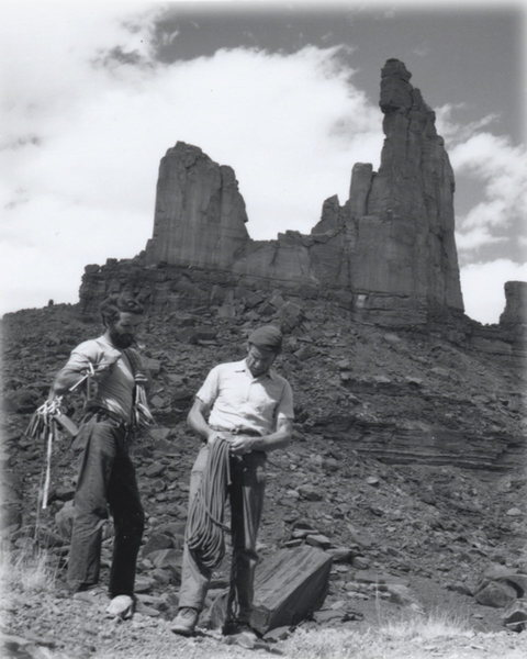 I've added a photo of the two first ascenitionists that is from the Museum of Moab. It was taken by Fran Barnes. The museum also has one of one of the two guys just about to summit. I'll try and get a copy of it from the records room. Its from afar and you can see the dust on the rock near the new bolts. I think we need to keep in mind that desert climbing required a different mindset then. There were no large cams to utilize when going up the crack, etc.