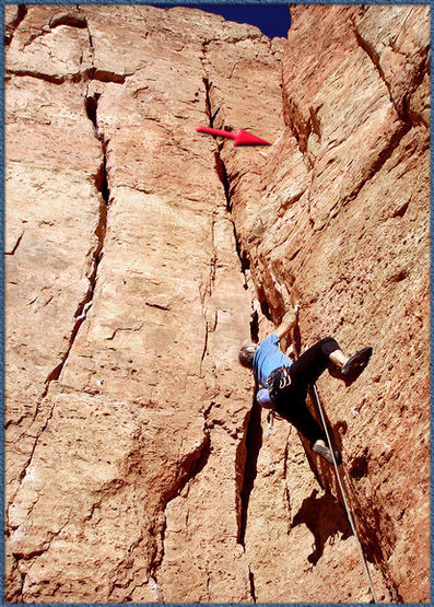 Finger pickin' up Hero ...  with location of loose rock at arrow.  Careful!