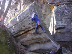 Rock Climbing Photo: Rhoads turning over the top-out, scary!