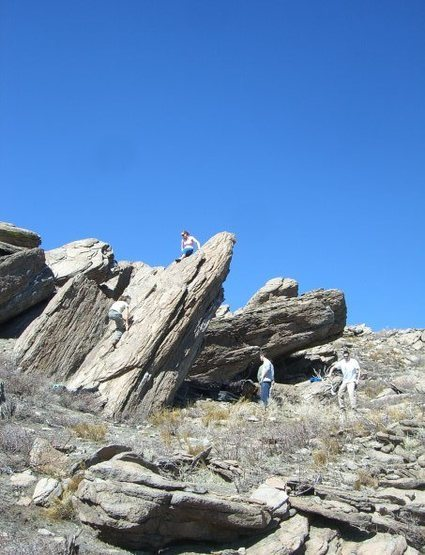 """Climbers on backside of Sharktooth.  You can see """"the overhang boulder"""" behind the people on the ground"""