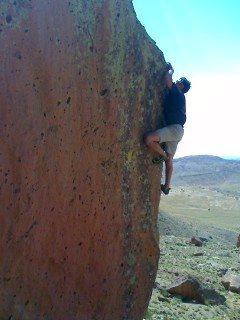 John Duran bouldering on Dine' lands.