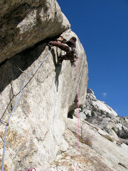 Lance climbing the 5.11d bulge pitch of the Lateral Fin.