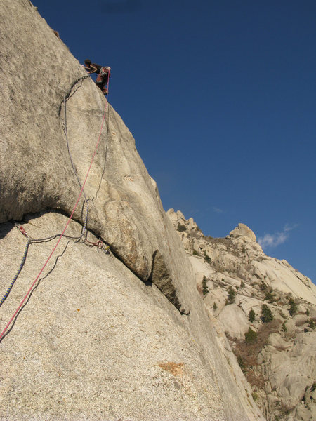 Lance climbing the crux section on the FFA of the Lateral Fin.