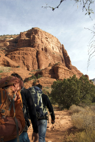 approaching Coyote Tower on Courthouse Butte.  Route ascends close to right skyline finishing just shy of butte top. After passing tower on right go to edge of Butte on main tourist trail and then angle back left up slabs diagonally to start up and left a few hundred feet up the cliff wall