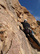 Rock Climbing Photo: Moving past the first bolt on Token of My Extreme.