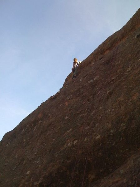 West face of Teaching Rock.  Climber is on 5.9 Teaching Left Route.  Teaching Center (5.6) also shown.