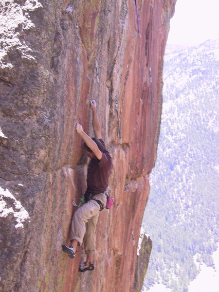 Ted on the final crux moves of the Quickening. Third Millennium and Grand Ole Opry visible to the right.  Photo by Jay Perry.