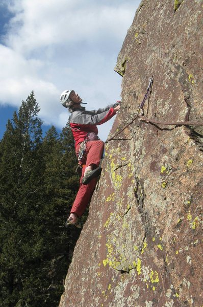 At the end of the leftwards traverse, looking up at the second bolt. Photo by Ken Parker.